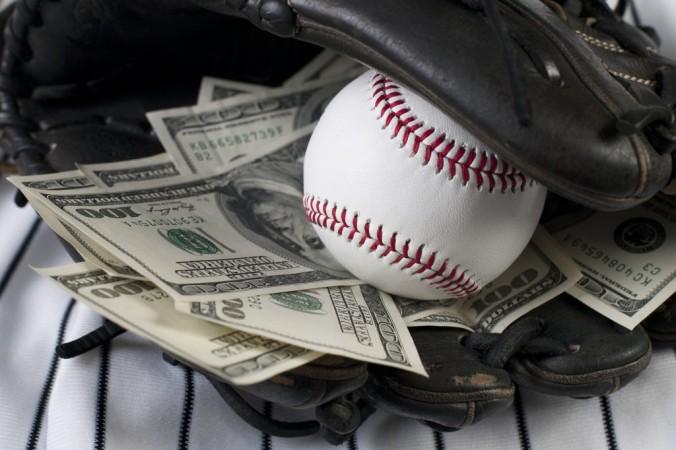 bigstock-Business-Of-Baseball-And-Money-34450892-1024x682